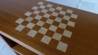 Andiroba coffe table with maple chess inlay