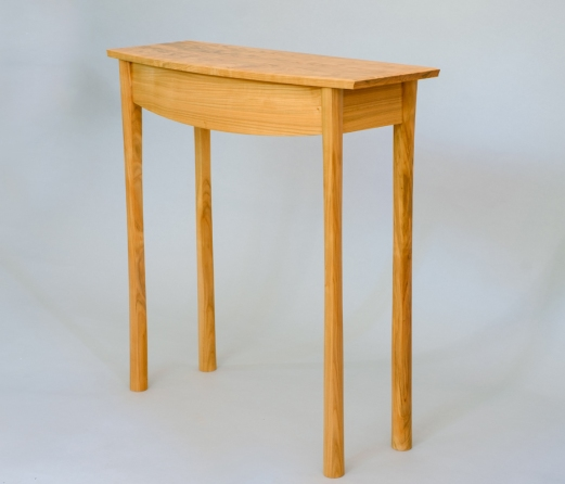Side table in Welsh cherry with bow front drawer