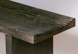 The scorching gives relief to the coarse crown cut grain of the oak. The differing hardness of the spring and late summer wood becomes three dimensional - the silver grain is also preserved